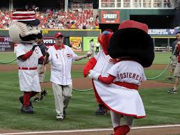 Being greeted by Rosie Redlegs after throwing out the first pitch in Cincinnati